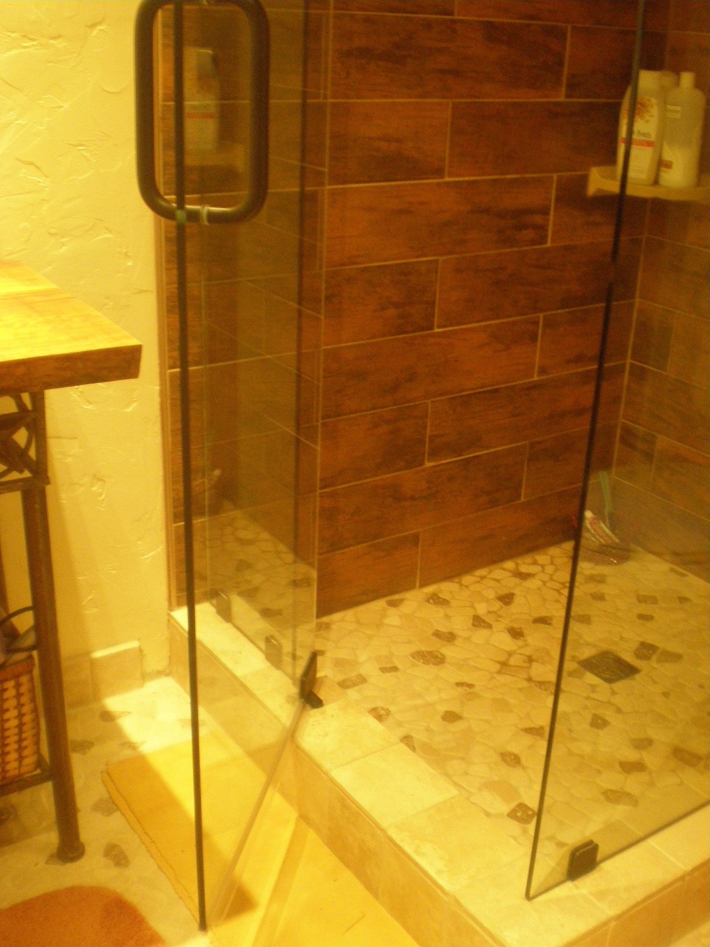 Added the Shower glass Door swings in or out Shower wall tile has