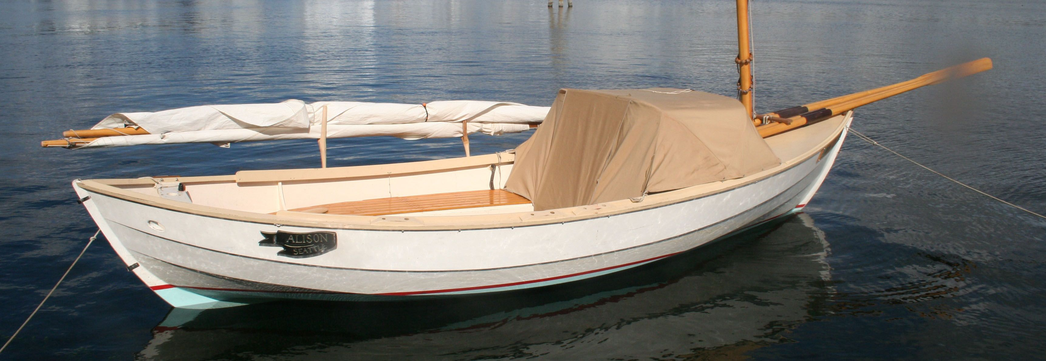 Caledonia Yawl Rig and Oar Storage idea from Small Boats