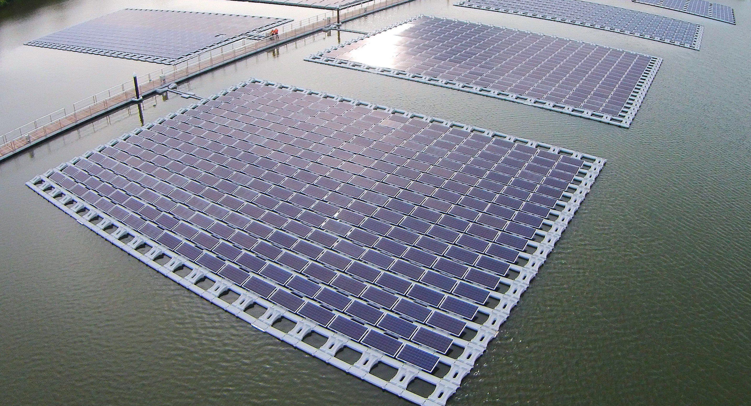First Floating Pv Project Tengah Reservoir200 Kilowatt Peak Kwp Roof Solar Panel Solar Panels Floating