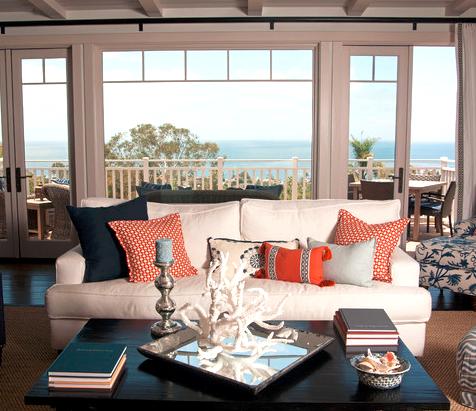 Go Coastal With Blue And Orange Room Decor Living Room Orange Coastal Living Rooms Coral Living Rooms
