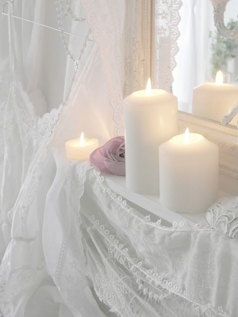 white candles and lace