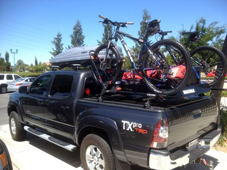 Toyota Tacoma With Yakima Bike Racks And A Thule Cargo Box