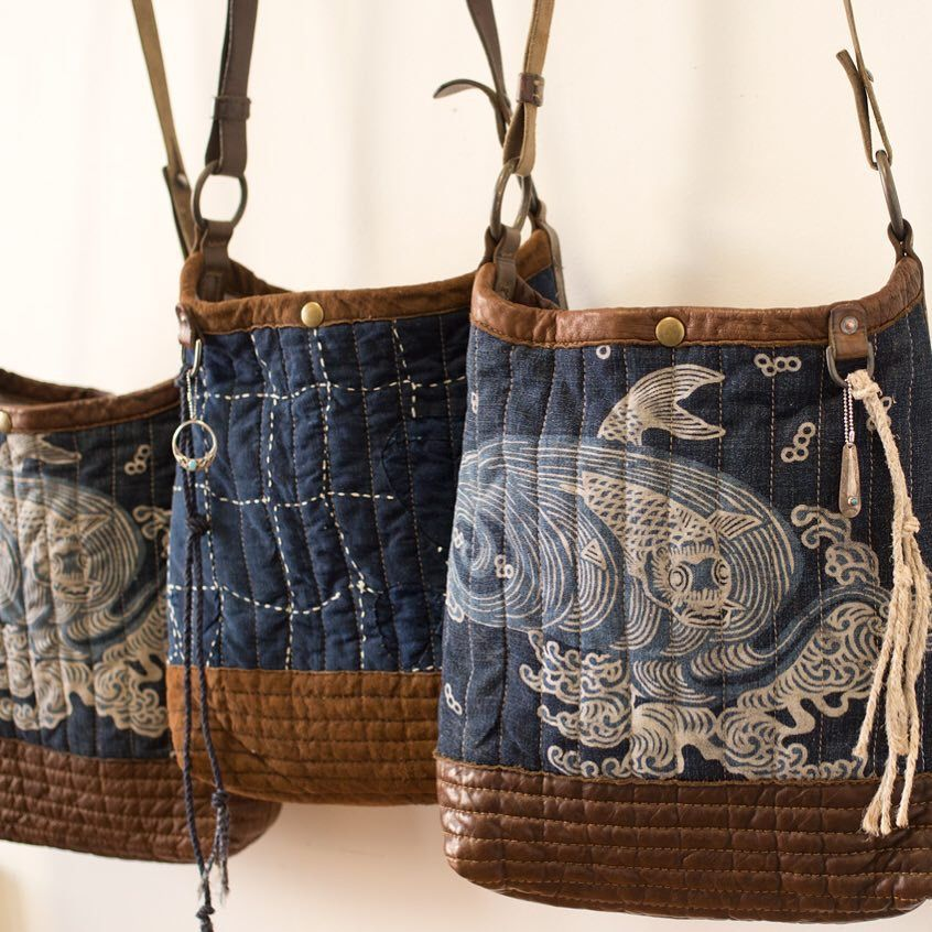 paint design onto bag using bleach, pool chlorine or similar. wash and rinse well before sewing.