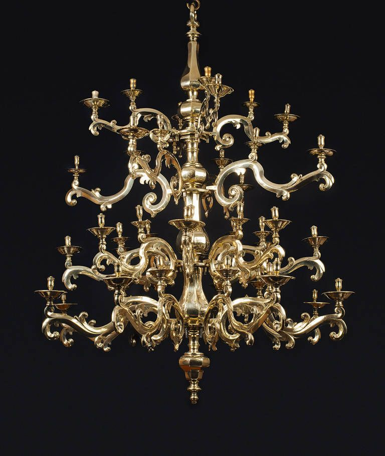 This is an exceptional gilt bronze chandelier with four rings of branches on a central balustered body. It holds forty eight lights.     fashioned out of elegant canting on the central body and graceful foliate branches.  $127,000   1650 Bronze  H:	5 ft. 2.6 in.  D:	4 ft. 8.7 in.