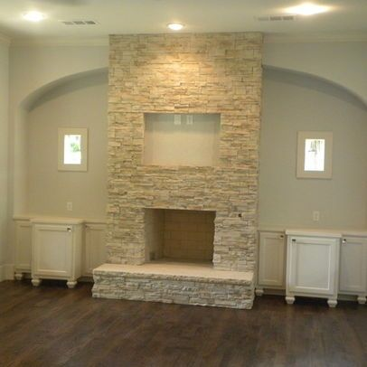 Stacked stone fireplace design ideas pictures remodel for Small stone fireplace designs