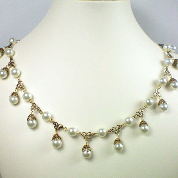 Jane Seymour pearl tier necklace.