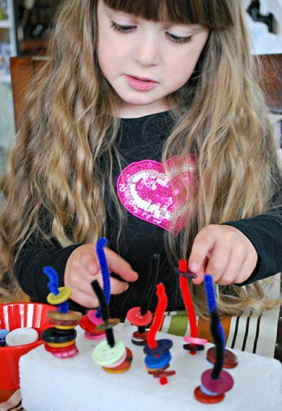 Toddler Talk: Buttons and Pipe Cleaners: A stacking activity that develops fine motor skills
