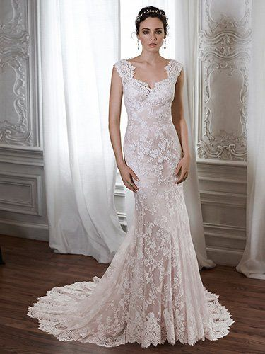 Maggie Sottero - LONDYN, Made from exquisite floral lace, this sheath gown is the epitome of romance. Complete with a scalloped lace neckline and illusion lace back. Finished with covered button over zipper back closure.