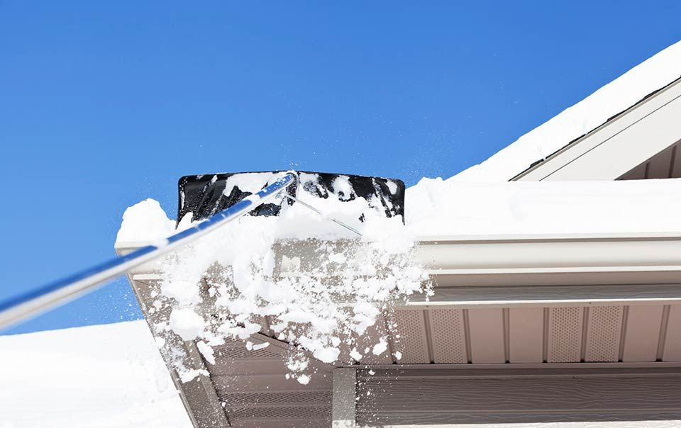 Removing Snow From The Roof Snow Removal Ice Dams Roof Installation