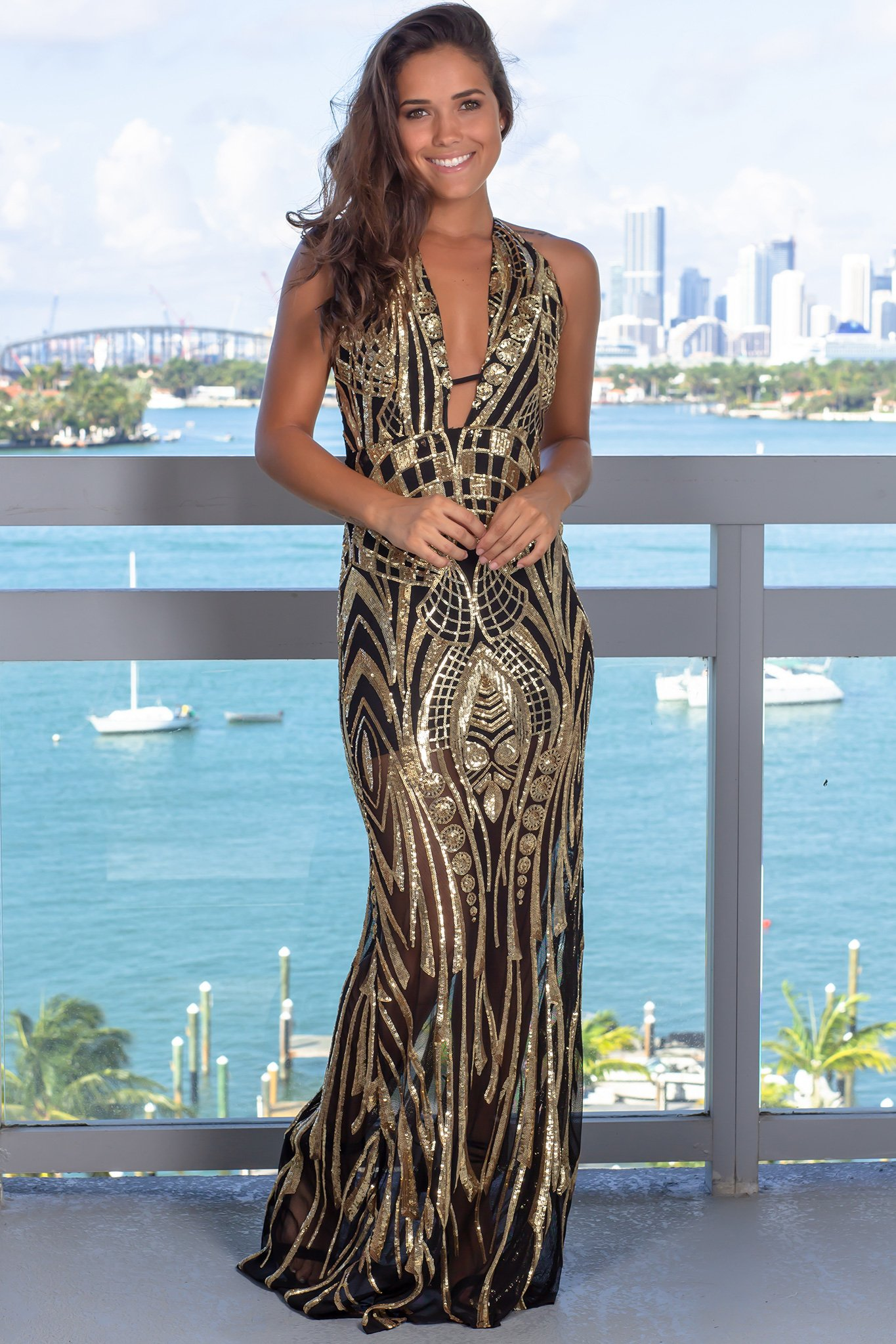 f283cda3 This Black and Gold Halter Neck Maxi Dress is stunning! The sequin  detailing is gorgeous
