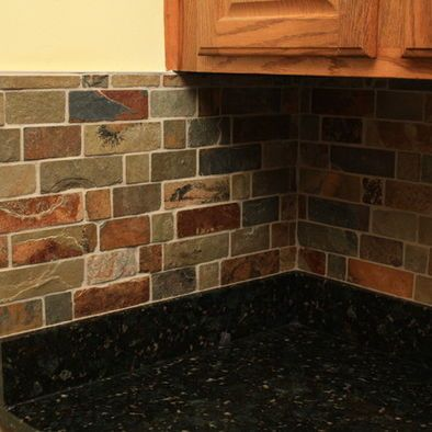 Kitchen with black granite counters and slate backsplash. This is a ...