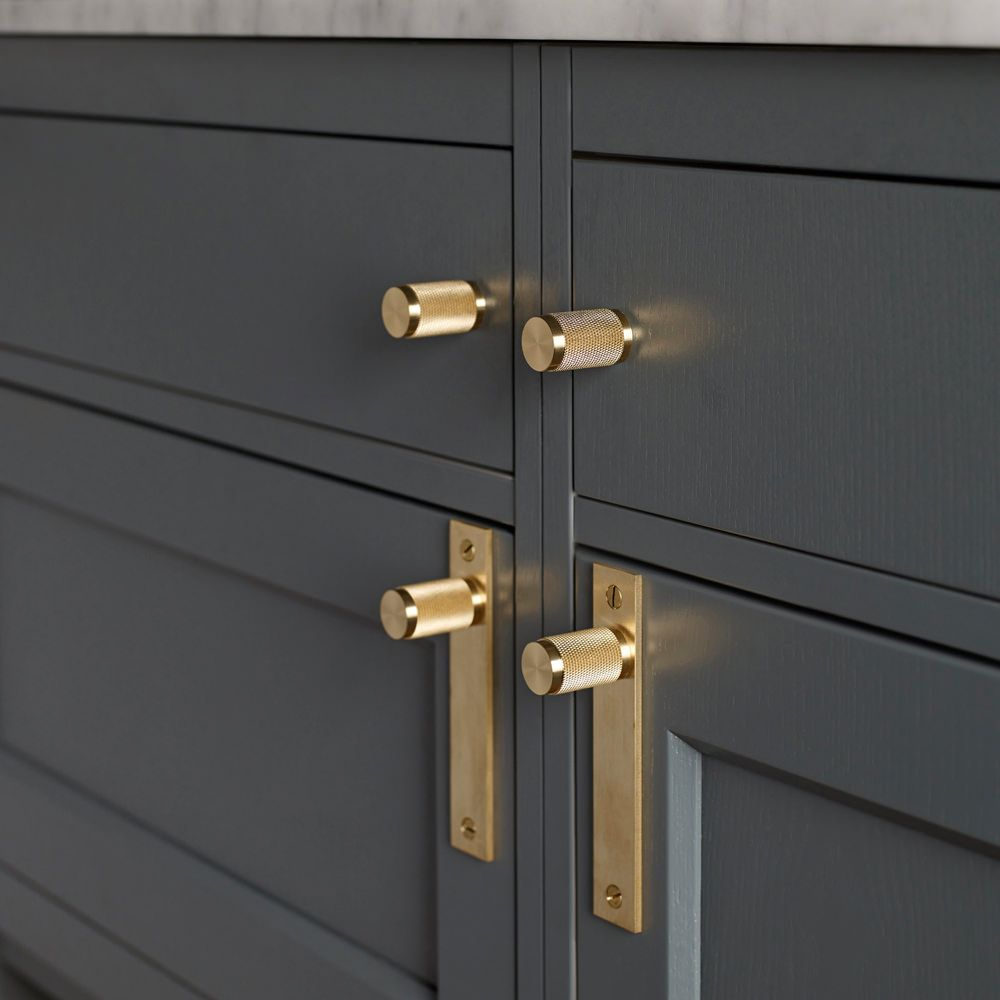 kitchen door handles id probably recommend a black or steel finish though as the brass wont really go with the cupboard finish - Kitchen Door Knobs