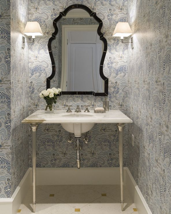 sophisticated powder room boasts black and blue zebra wallpaper on