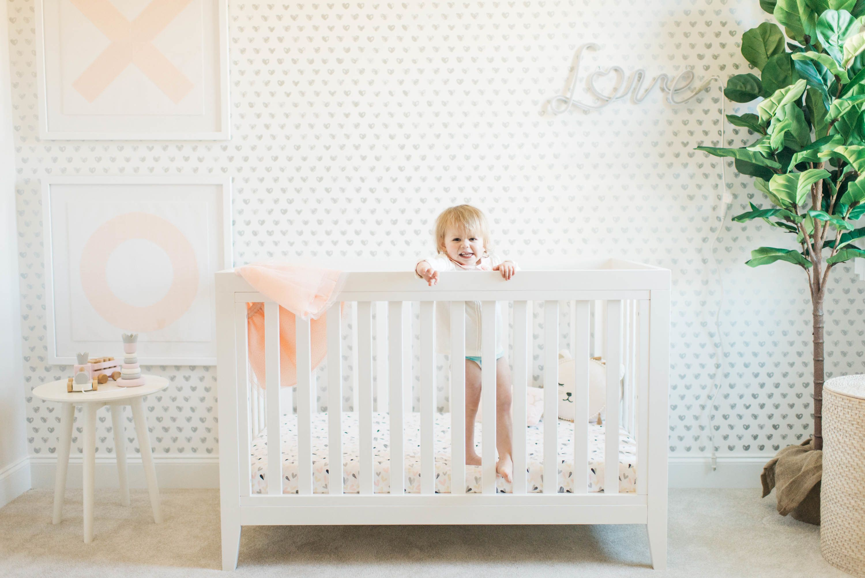 Pink, Gray and White Girl's Nursery from @projectnursery and featuring fab pieces from @potterybarnkids. #PNpartner