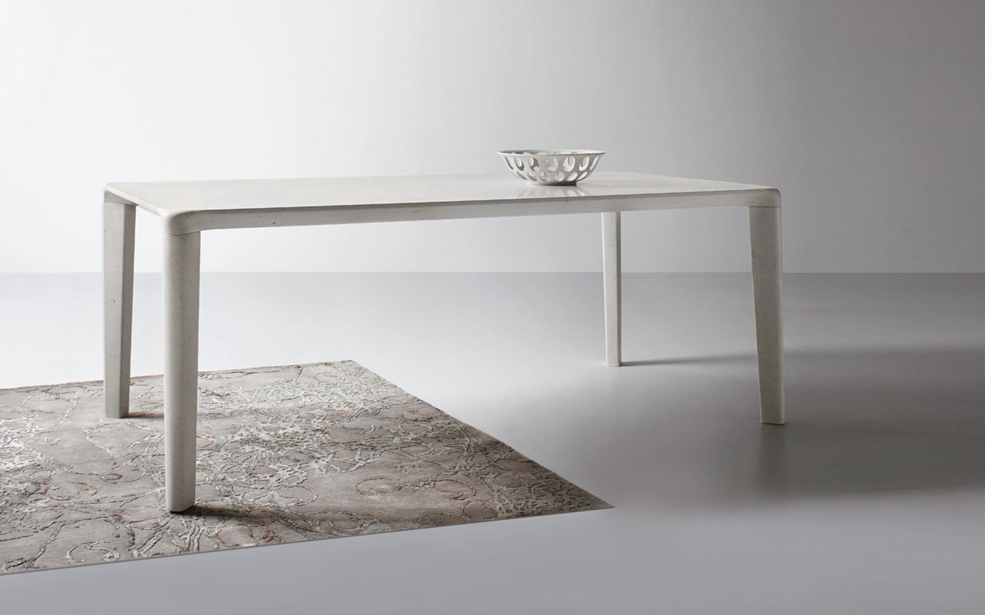 Neos by Neutra is a custom made dining table carved from a unique block of solid stone. Available from Pure Interiors.