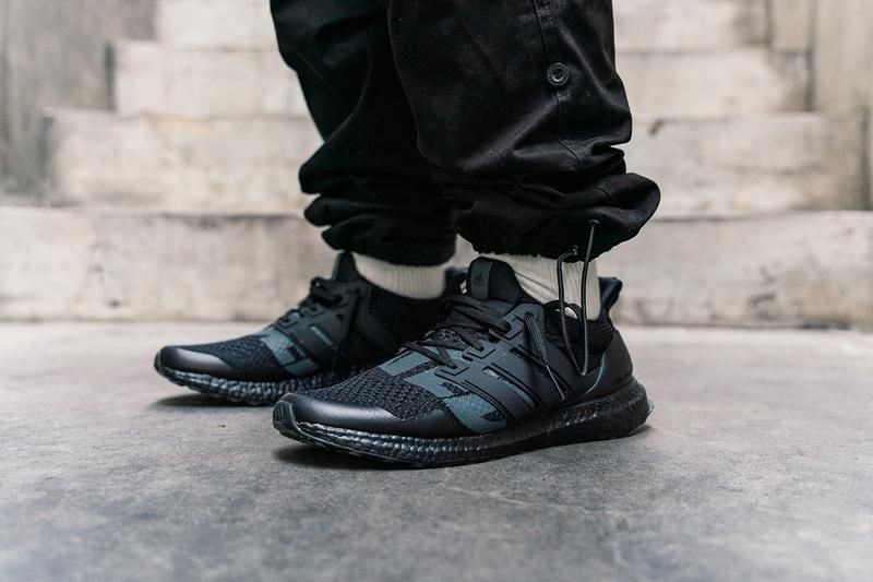 An On Foot Look At Undefeated S Adidas Ultraboost Collaboration Adidas Ultra Boost Ultra Boost All Black Sneakers