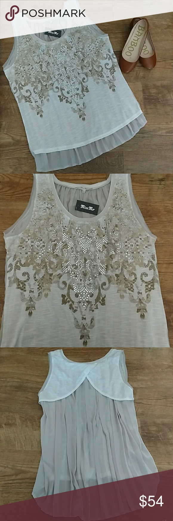 NEW MISS ME HIGH LOW GRAPHIC TEE New Miss Me High low tank w a tan and gold graphic design w clear crystals and the back is a pleated sheer material. The front is a ivory jersey material and the back is a cream sheer material, and is 100% polyester. Miss Me Tops Tank Tops