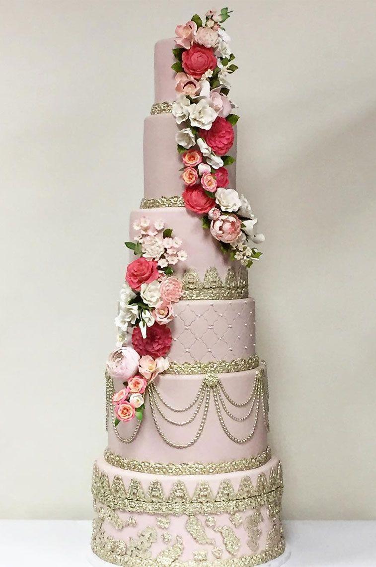 Blush pink elegant wedding cake with cascading flowers