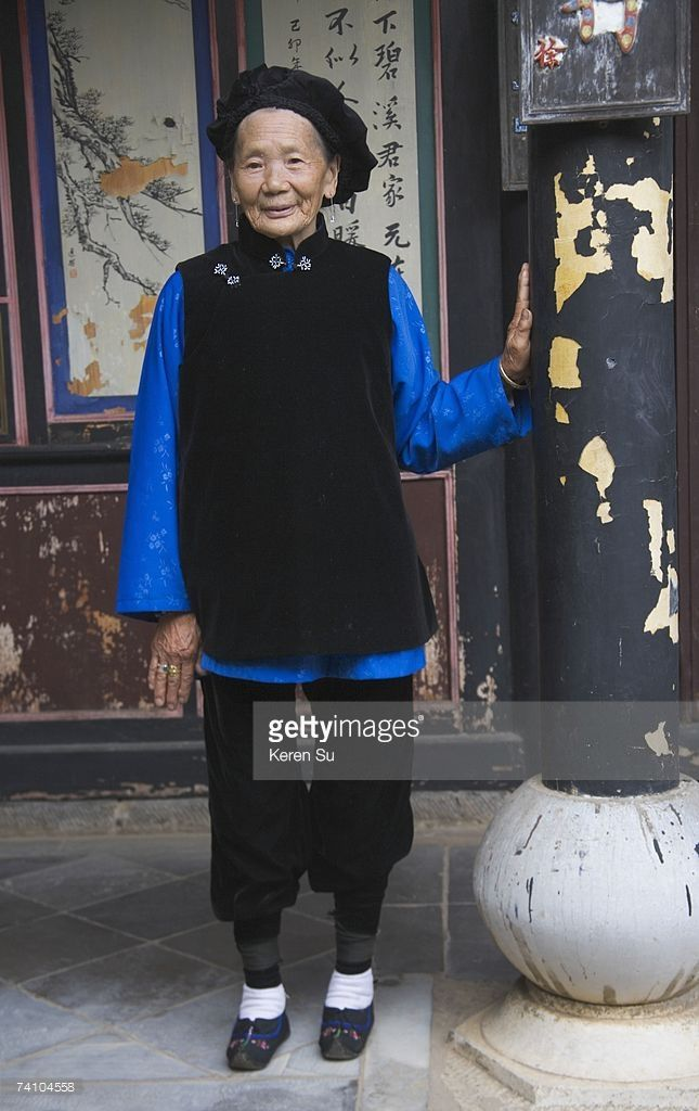 Stock Photo : China, Yunnan Province, 90 year old lady with bound feet at traditional house