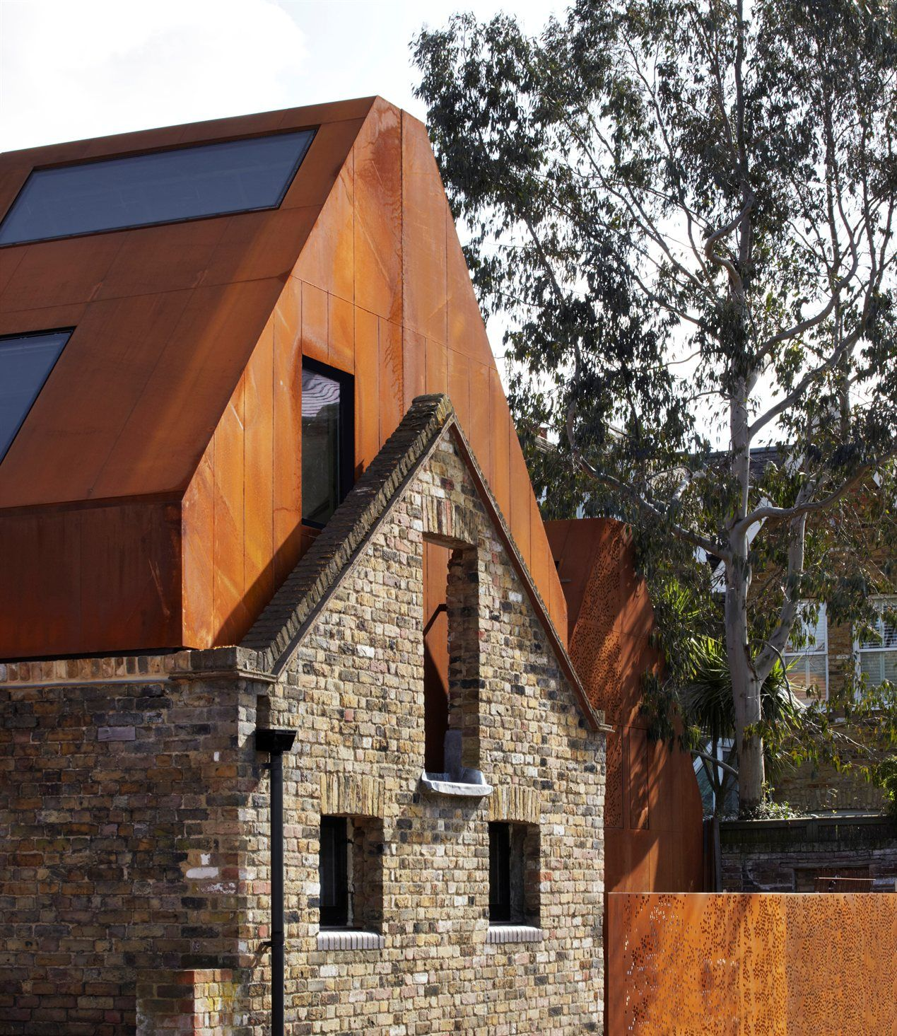 Kew House Jack Hobhouse I Love The Perforated Weathering Steel Cladding And The Old Brick Work Renovation Architecture Architecture Modern Architecture