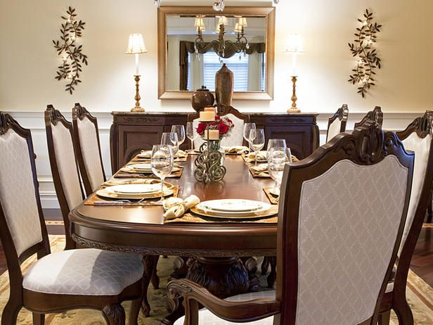 traditional dining table setting lit by chandelier - Traditional Dining Room Sets