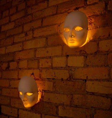 DIY Just cover your porch or front lights with plain white masks for an eerie ghost effect Halloween decorations.