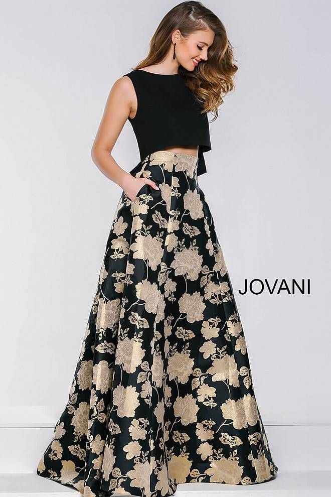 a7b5339a941 Floral print two piece dress features a black sleeveless top and a floral  floor length skirt with pockets in the front and a hidden zipper in the  back.