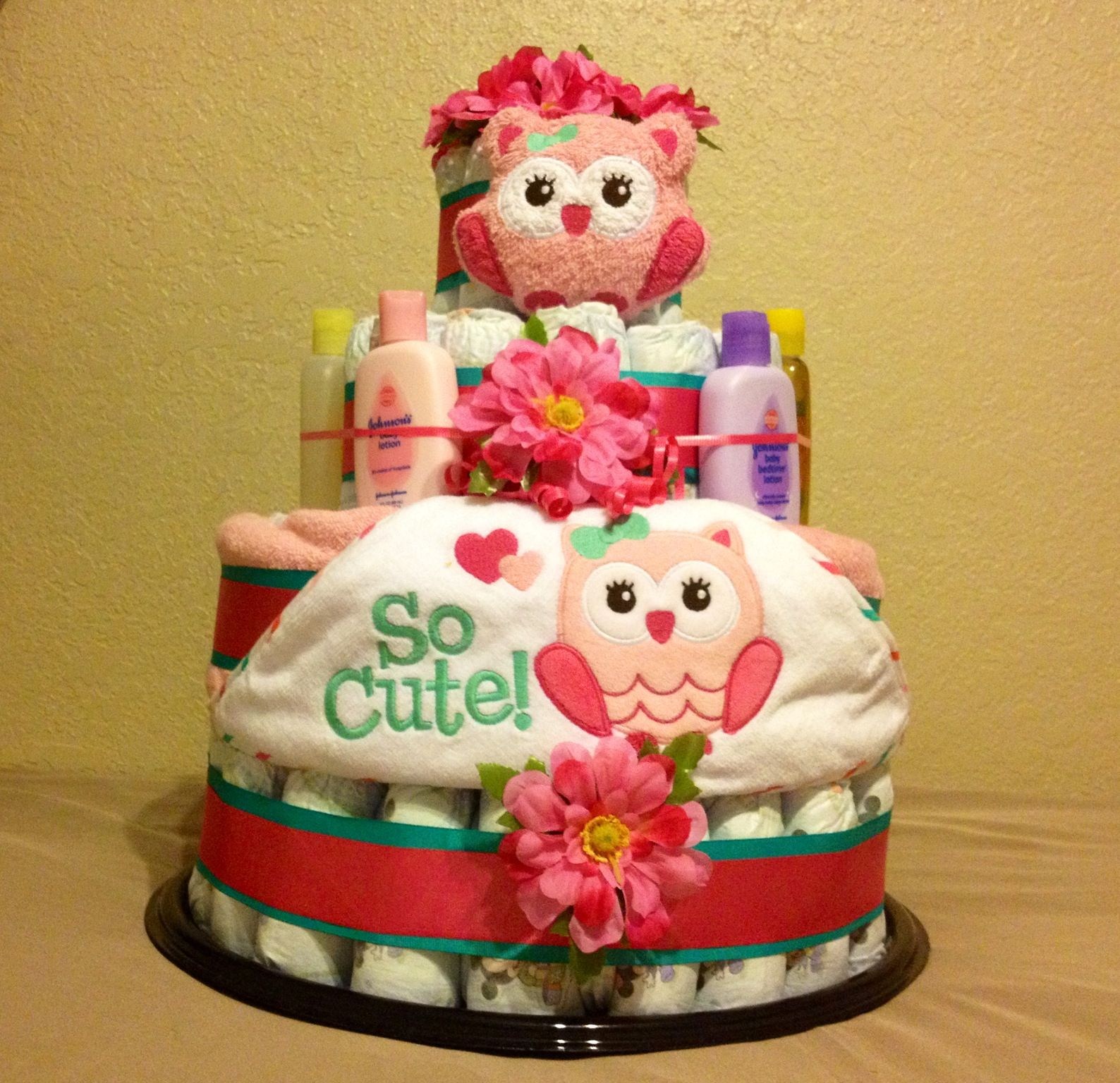 An owl themed diaper cake i made for my friends baby shower an owl themed diaper cake i made for my friends baby shower negle Images