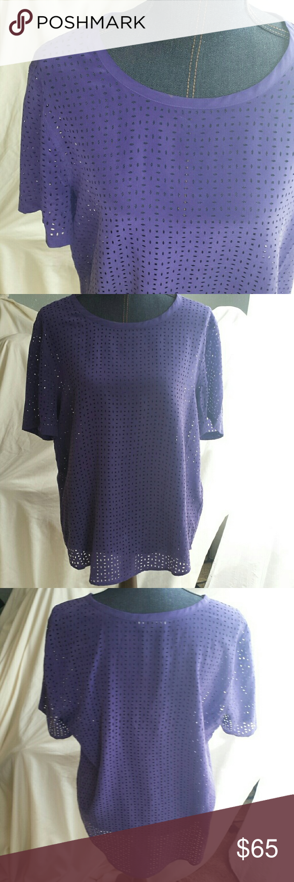 Intricately cut silk tunic 100% silk top with lots of laser cut openings. Wear a bright color underneath to pop the pattern or dark to be subtle.  Looks great tucked in as well Equipment  Tops Tunics