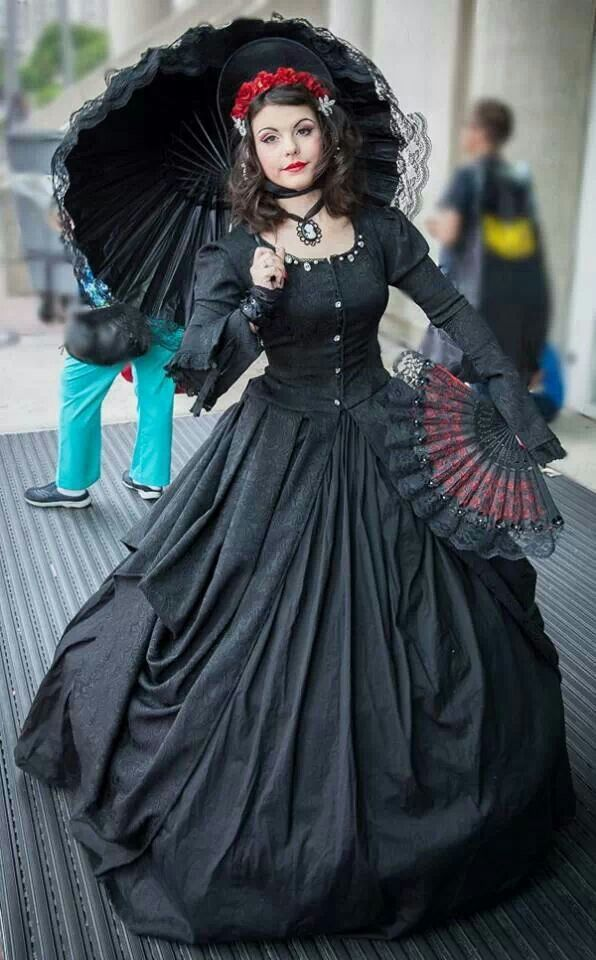 Gothic Girl Gorgeous black outfit with wide skirt parasol and fan.