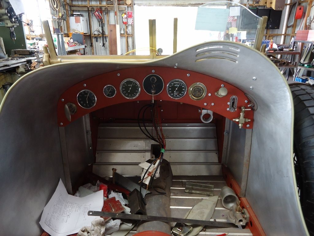 Completed dash with a replica Bosch starter and magneto