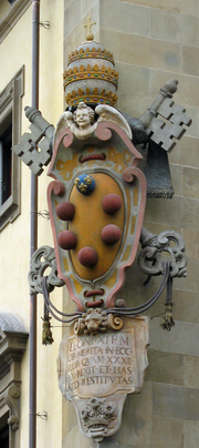 The Medici family crest/coat of arms, on a building in Florence, Italy