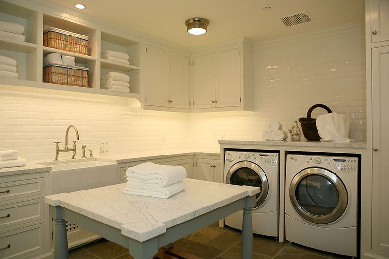 Clean white laundry room, marble topped folding table...   Laundry ...