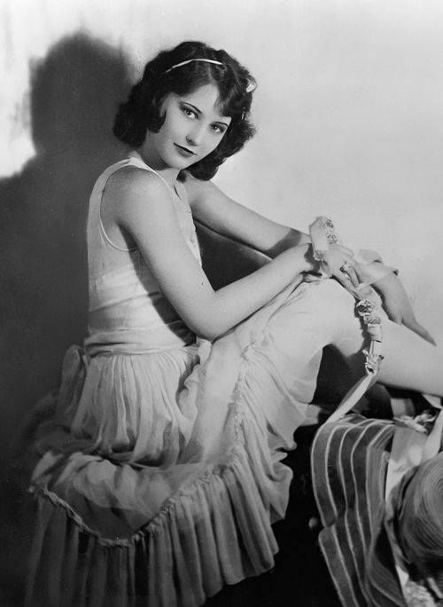 A young and beautiful Miss Stanwyck.