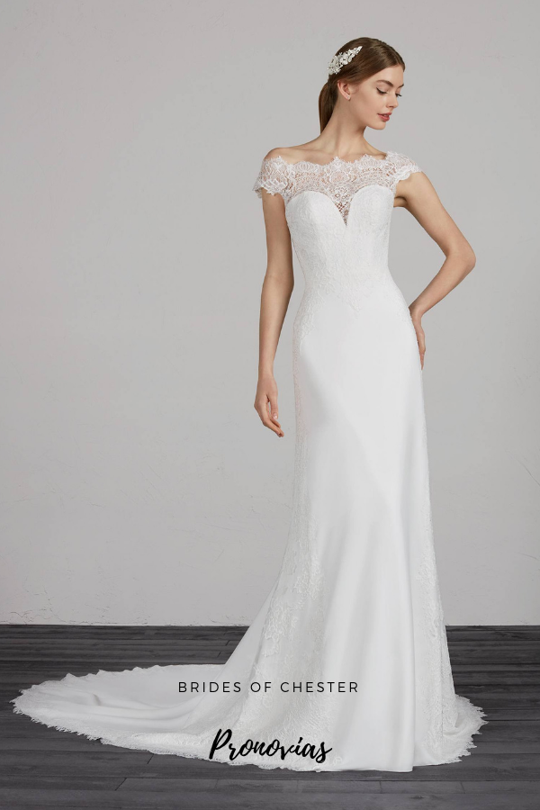 A slim Aline crepe wedding dress featuring offthe