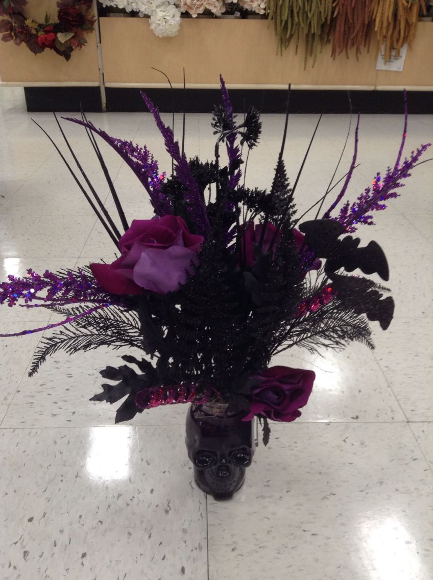 Halloween floral arrangement of black and purple bouquet in a purple halloween floral arrangement of black and purple bouquet in a purple glass skull izmirmasajfo Choice Image