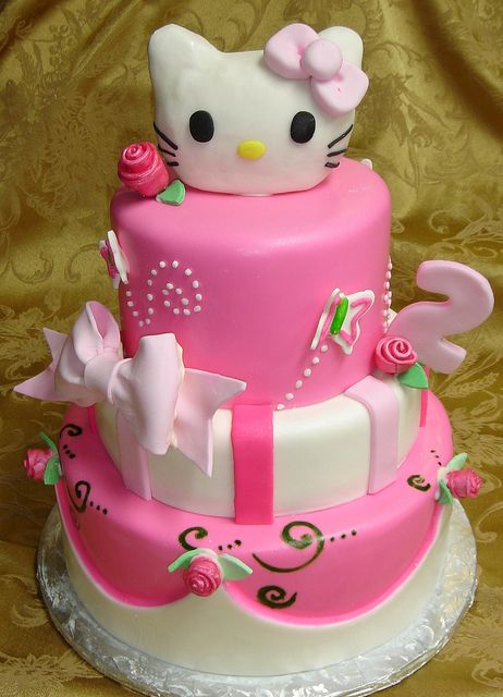 Three Tier Pink And White Fondant Custom Designed Hello Kitty 2nd Birthday Cake Withe Roses And Bows Second Birthday Cakes Hello Kitty Cake Girl Cakes