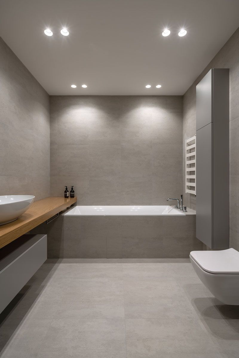 Bathroom Idea – A Modern Grey Bathroom With Built-In Bathtub And Wood Vanity