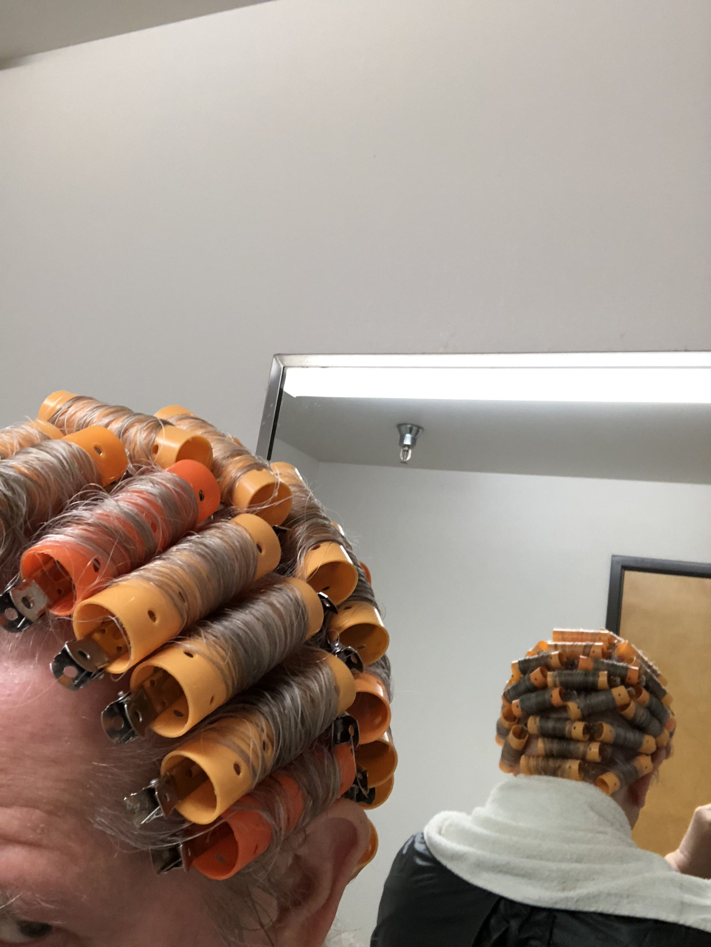 His wife said use the orange rollers this time. Hair