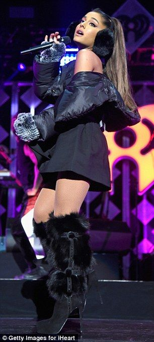 Madison Square Garden · Ariana Grande Sports Fluffy Ear Muffs And Warm  Padded Coat On Stage At Jingle Ball In