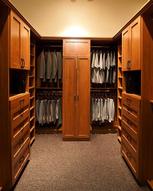 Wood Walk In Closet By Classy Closets Featuring Symmetrical Hanging Space,  Drawers And Cabinets