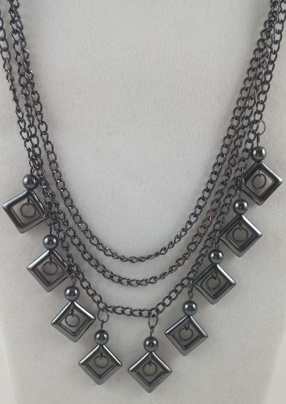 The chain here is preformed, you just cut to length of choice and connect w/ jumps and clasps.  The dangle charms were made using wire, beads, jumps and square components.  Has a beautiful drape to it!
