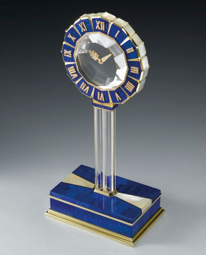 CARTIER 'THE LAPIS LAZULI AND ROCK CRYSTAL SINGLE STEM MYSTERY CLOCK'