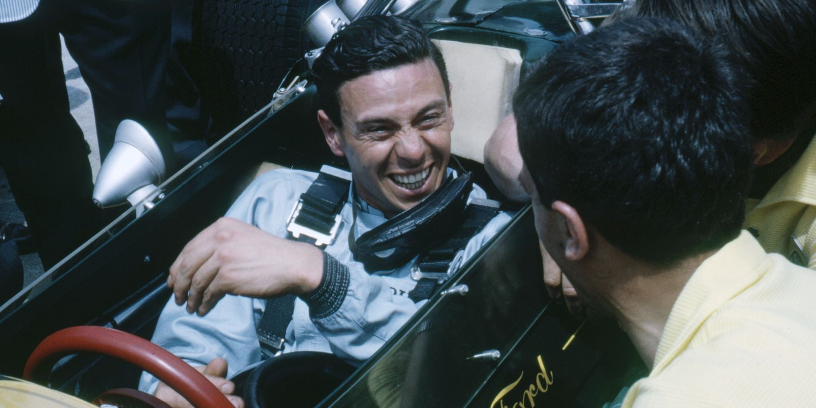 F1 Drivers At IMS: Jim Clark — Jim Clark laughing in the cockpit