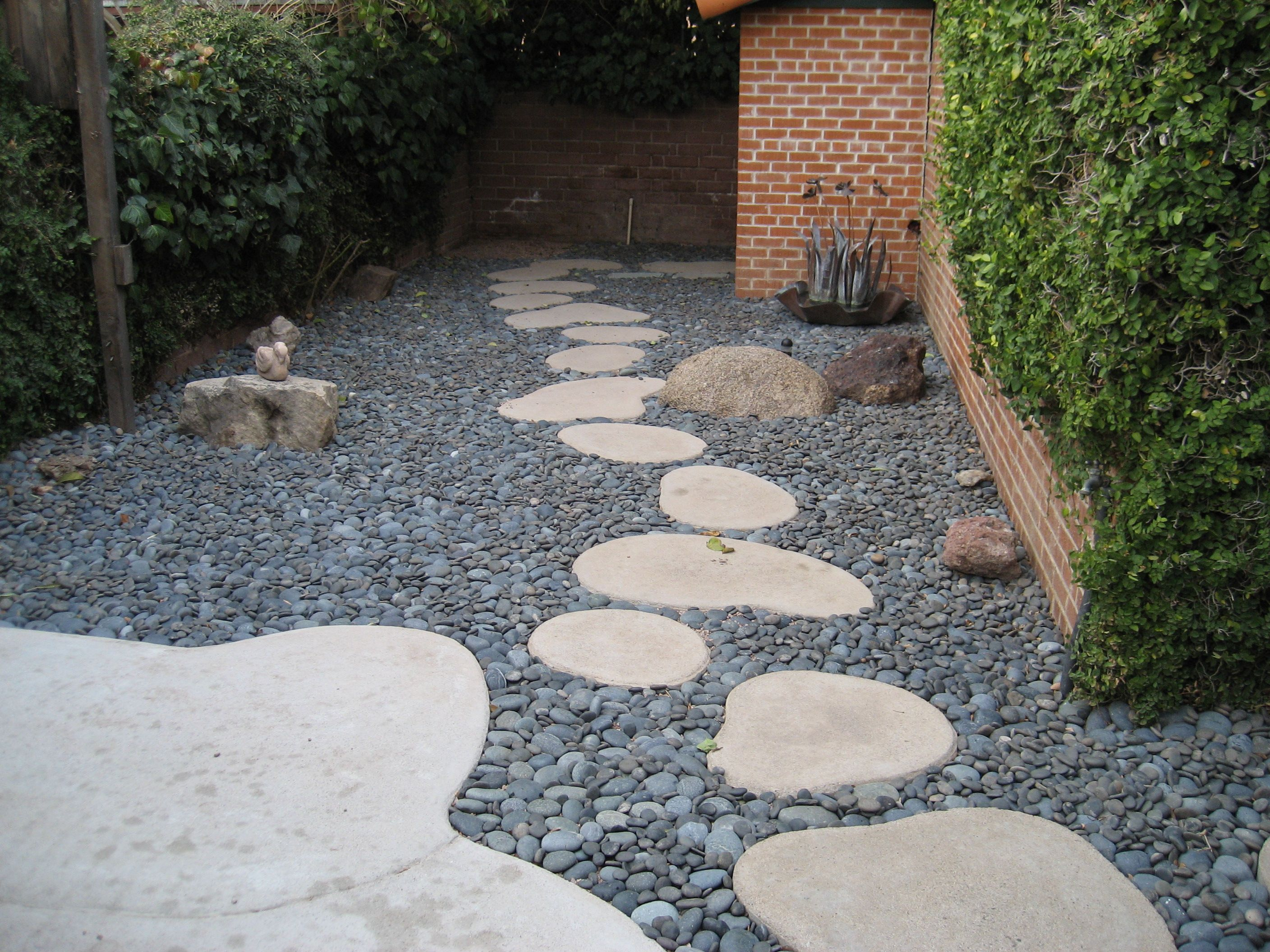 round stepping stones mexican pebbles Google Search Backyard