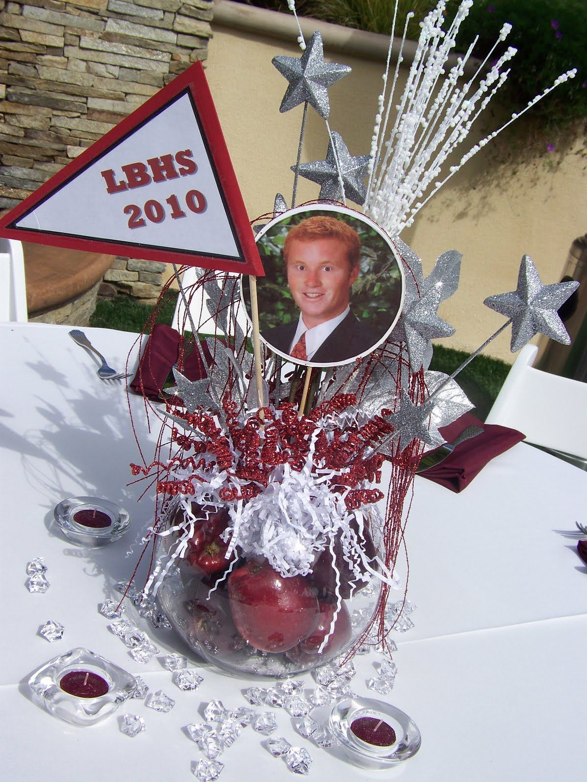 Graduation party centerpiece ideas using photos and school
