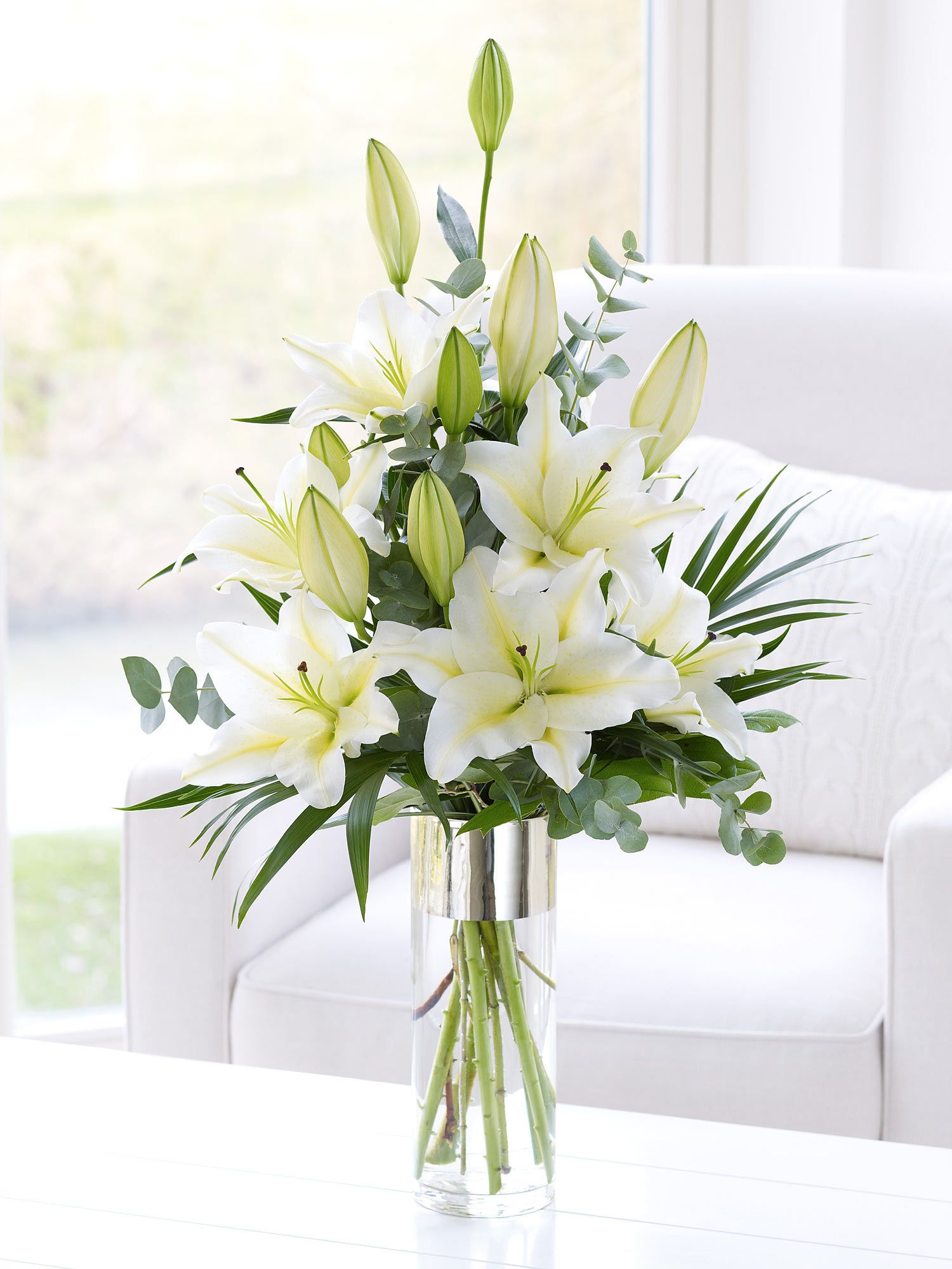 white scented lily vase  interflora semi lshaped arrangement  - simple bouquet of white oriental lilies beautifully arranged by venusflowers placed in a vase