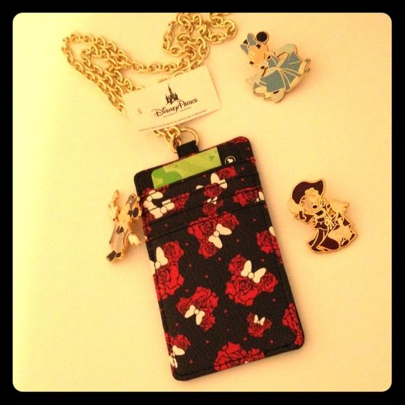 BOGO 1/2 OFFMinnie Mouse Lanyard & Wallet Bring a piece of the magic to you with this adorable lanyard/wallet from Disney! Four slots with a clear ID slot on the reverse side, faux leather patterned with roses shaped in Minnie's silhouette. Fifteen inch long gold chain, NWT, never used! Purchased at Tren-D, a Downtown Disney boutique. TRADESLOWBALLINGPAYPAL✅BUNDLES✅REASONABLE OFFERS✅ Happy Poshing!  Disney Accessories