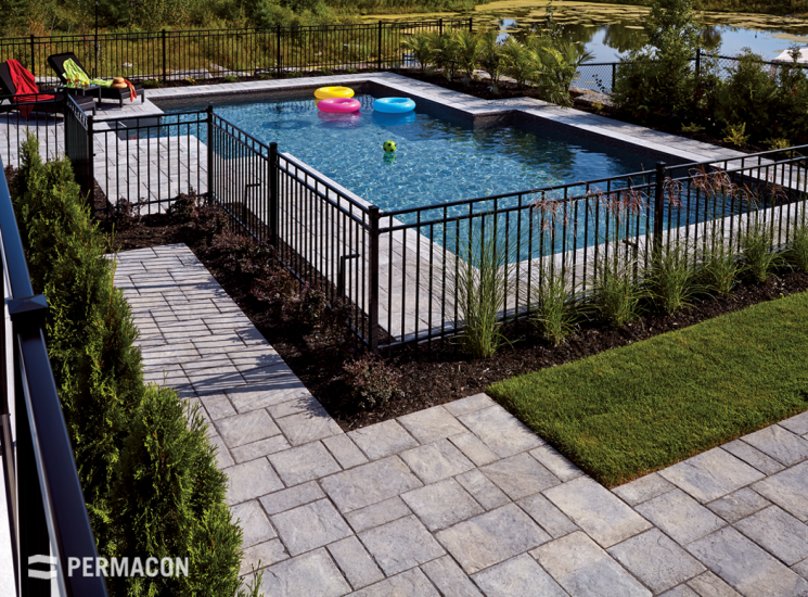 Function Meets Beauty With This Paver S Natural Chiseled Stone Texture Rendre Inground Pool Landscaping Backyard Pool Landscaping Landscaping Around Pool