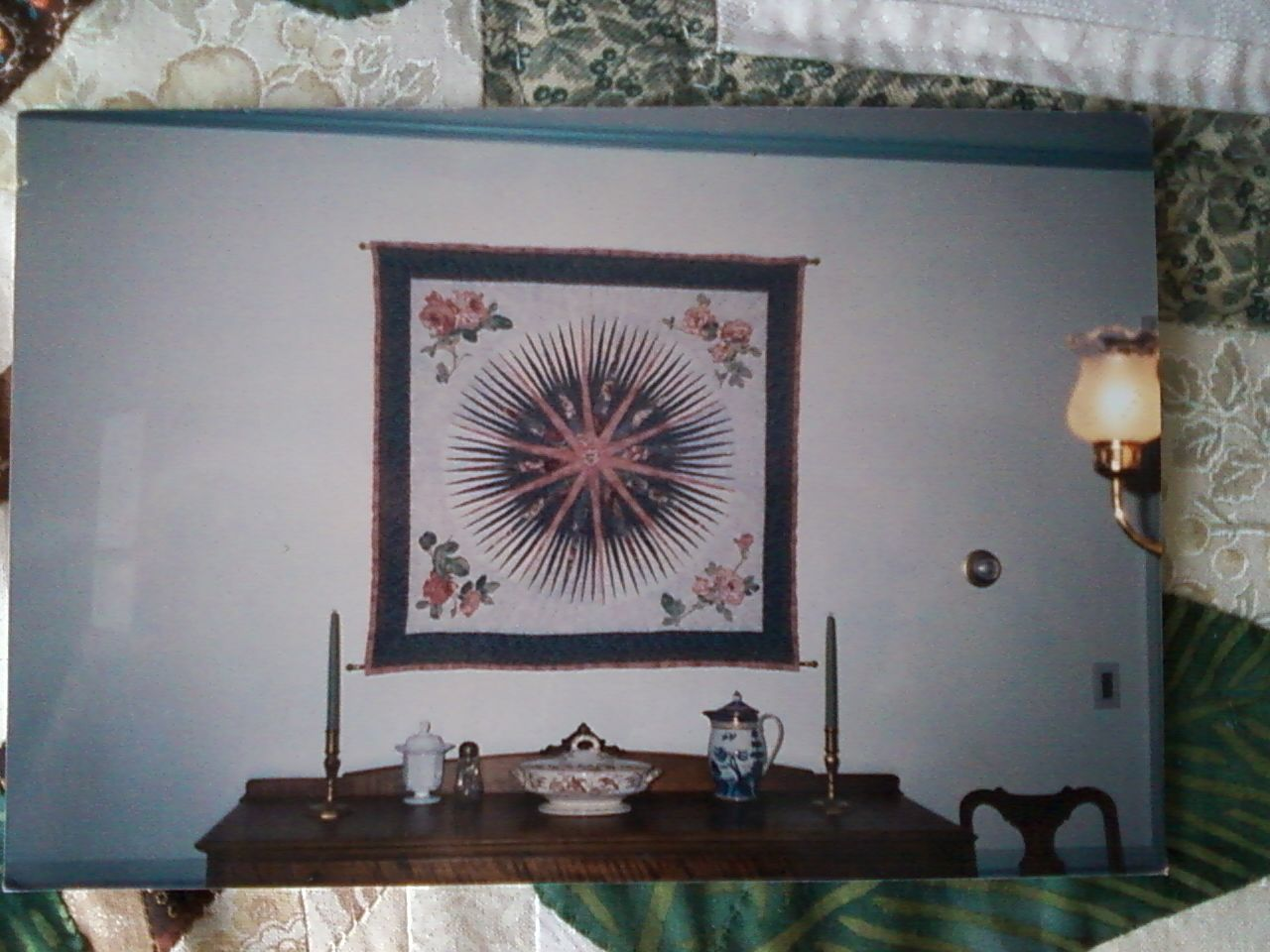 Wall hanging I made for my mom. Mariner's compass with floral applique.